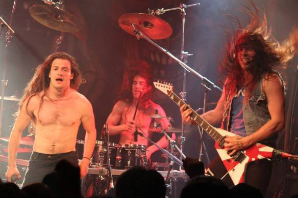Brian Stephenson, JJ Tartaglia and Zach Slaughter of Skull Fist on stage in Tokyo. Photo: Stefan Nilsson
